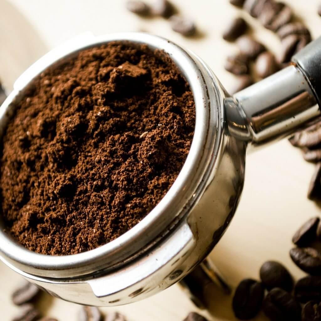 coffee hopper full of coffee grind