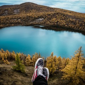 feet in front of a great view of a lake