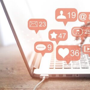Social Media like and share icons on laptop